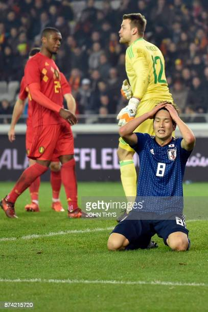 Japan's forward Genki Haraguchi reacts after missing a goal opportunity during the friendly football match Belgium vs Japan on November 14 2017 in...