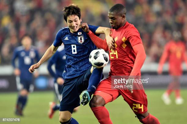Japan's forward Genki Haraguchi vies with Belgium's Christian Kabasele during the friendly football match Belgium vs Japan on November 14 2017 in...
