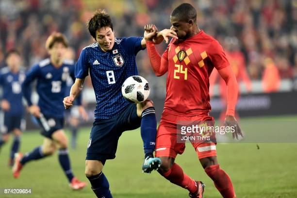 Japan's forward Genki Haraguchi vies with Belgium's Christian Kabasele R during the friendly football match Belgium vs Japan on November 14 2017 in...