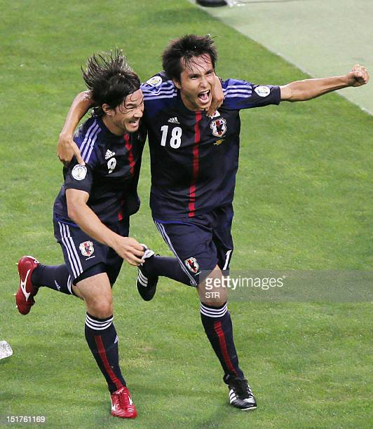 Japan's forward Ryoichi Maeda celebrates with his teammate Shinji Okazaki after he scored a goal against Iraq during their FIFA World Cup qualifying...