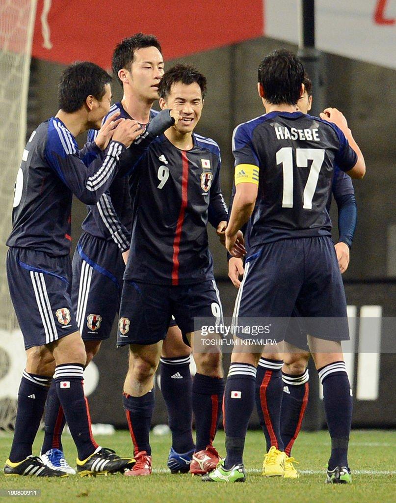 Japan's forward Shinji Okazaki (C) celebrates his goal with teammates during their friendly match against Latvia in Kobe on February 6, 2013.