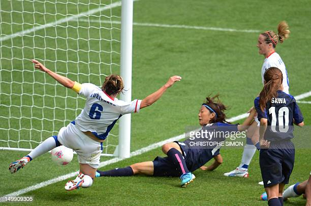 Japan's forward Yuki Ogimi scores in front of France's Sandrine Soubeyrand during their women's football semi final Japan vs France event at Wembley...