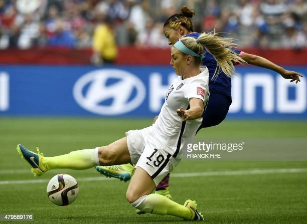 Japan's forward Yuki Ogimi vies with USA defender Julie Johnston before scoring a goal during the final football match between USA and Japan during...