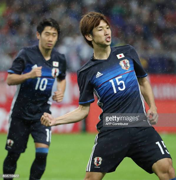 Japan's forward Yuya Osako celebrates his goal during their friendly football match against New Zealand in Toyota city Aichi prefecture on October 6...