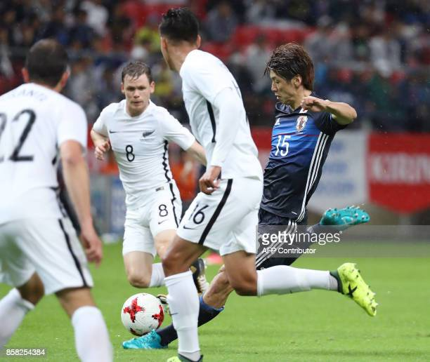 Japan's forward Yuya Osako shoots the ball among New Zealand's Andrew Durante Michael McGlinchey and Dane Ingham during their friendly football match...