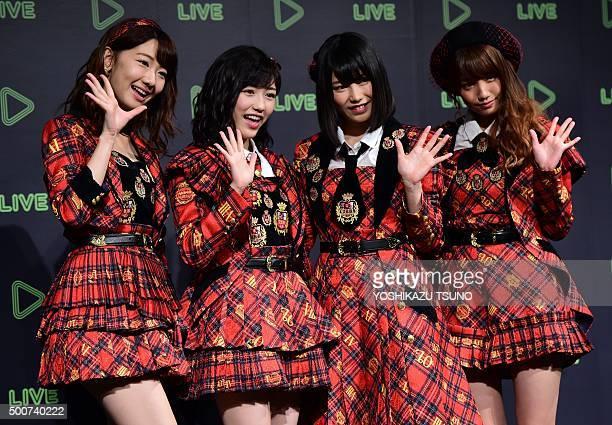 Japan's girl pop group AKB48 members Yuki Kashiwagi Mayu Watanabe Yui Yokoyama and Rena Kato pose for photographs as Japanese social networking...