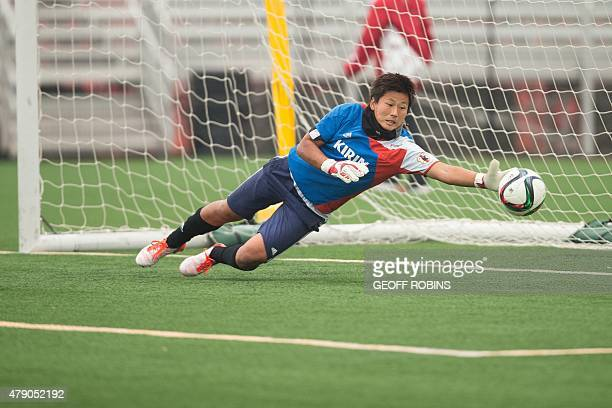 Japan's goalkeeper Ayumi Kaihori dives for a ball during the team's FIFA Women's World Cup training session in Edmonton Canada on June 30 2015 Japan...
