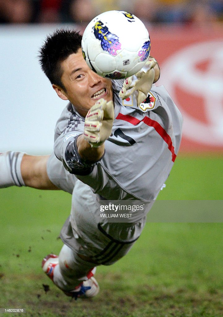 Japan's goalkeeper Eiji Kawashima dives to make a save during their 1-1 draw against Australia in their 2014 World Cup qualifying match, played in Brisbane on June 12, 2012. IMAGE STRICTLY RESTRICTED TO EDITORIAL USE - STRICTLY NO COMMERCIAL USE AFP PHOTO/William WEST