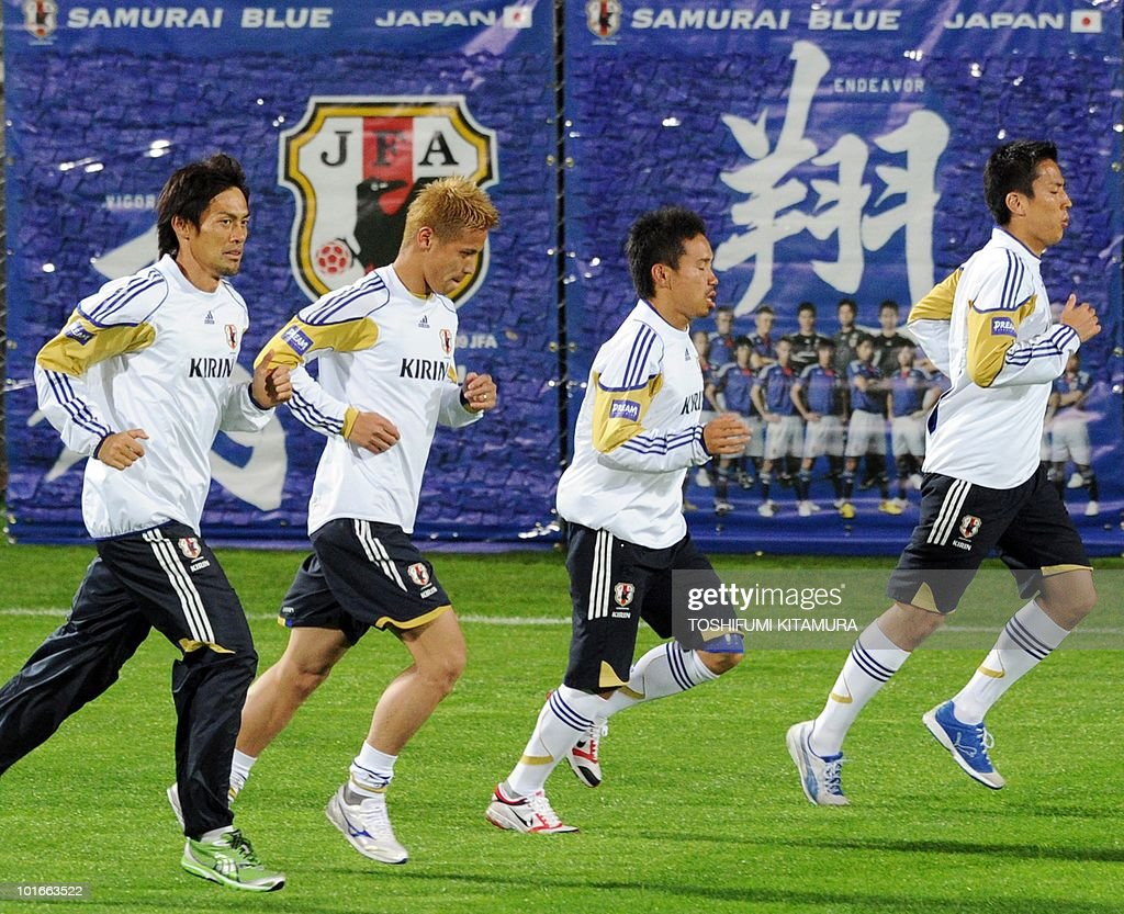 Japan's goalkeeper Seigo Narazaki, midfielder Keisuke Honda, defender Yuto Nagatomo and midfielder Makoto Hasebe jog during their team's first training session in George on June 6, 2010. Japan team arrived in George earlier in the day to hold their training camp ahead of the start of the 2010 World Cup football tournament.