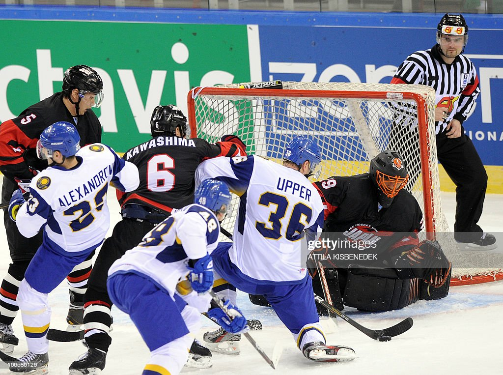 Japan's goalkeeper Yutaka Fukufuji tries to safe the ball during the IIHF Ice Hockey World Championship 2013 Division I Group A, Japan vs Kazakhstan in Budapest on April 14, 2013.