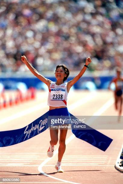Japan's gold medal winner Naoko Takanashi celebrates as she crosses the line