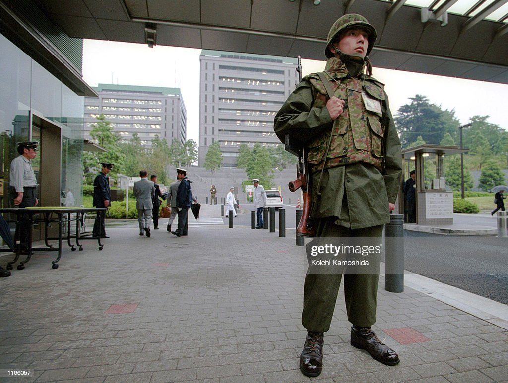 Japan's Ground SelfDefense Force personnel keep close watch at the front gate of the Defense Agency September 23 2001 in Tokyo The agency increased...
