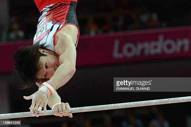 Japan's gymnast Kohei Uchimura performs on the horizontal bar during the men's individual allaround competition of the artistic gymnastics event of...