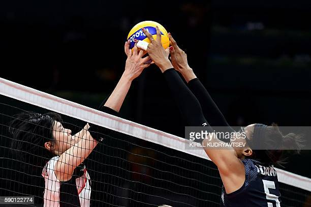 Japan's Haruka Miyashita competes with USA's Rachael Adams during the women's quarterfinal volleyball match between Japan and USA at the...