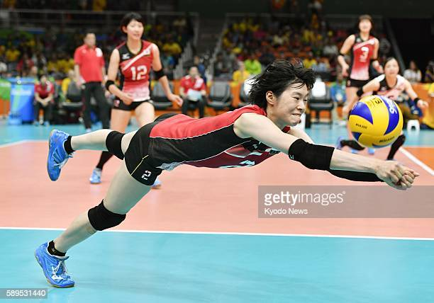 Japan's Haruka Miyashita dives for a dig against Argentina during the third set of their preliminaryround match in women's volleyball at the Rio de...