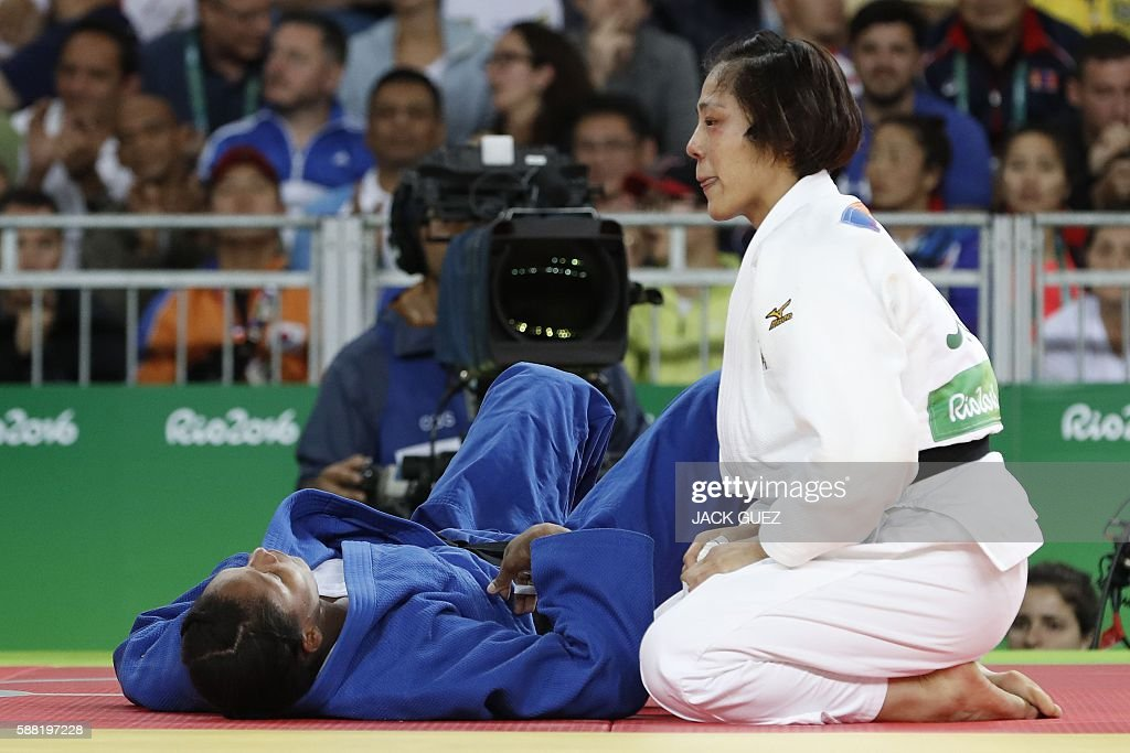 Japan's Haruka Tachimoto reacts after defeating Colombia's Yuri Alvear during their women's 70kg judo contest gold medal match of the Rio 2016...