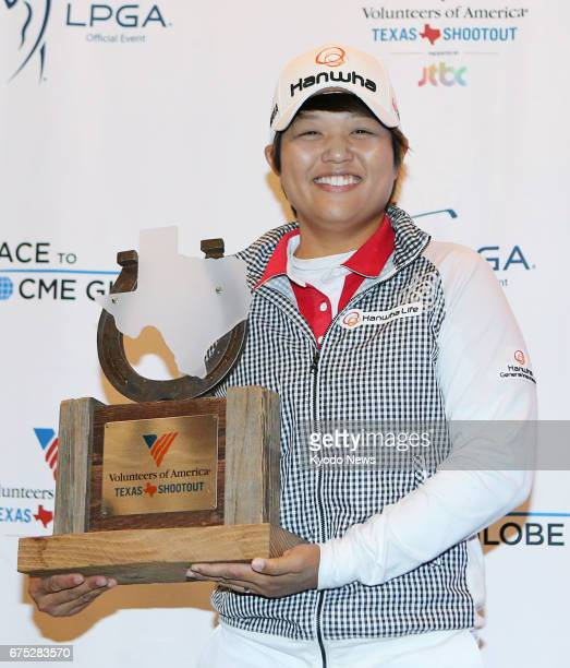 Japan's Harukyo Nomura holds her winner's trophy after defeating 20year veteran Cristie Kerr in a sixhole playoff on April 30 to earn her third LPGA...