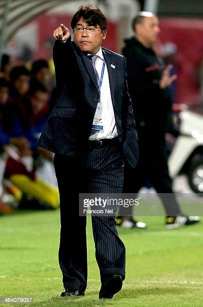 Japan's Head coach Makoto Teguramori gives instructions to his players during the AFC U22 Championship quarter final match between Iraq and Japan at...