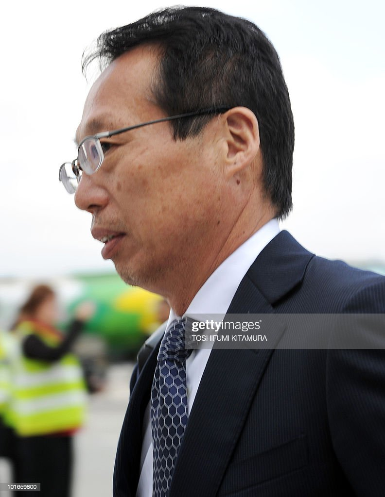 Japan's head coach Takeshi Okada walks toward the terminal upon the team's arrival at George airport on June 6, 2010. Japan's national football team arrived here to hold their 2010 World Cup training camp ahead of the start of the tournament on June 11.