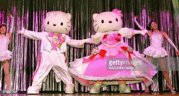 Japan's Hello Kitty the moonfaced mouthless white cat performs during her 30th birthday ceremony at the Sanrio Puroland in Tokyo 01 November 2004...
