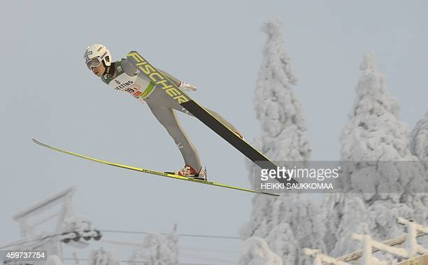 Japan's Hideaki Nagai soars through the air during the Nordic Combined team sprint's ski jumping competition at the FIS World Cup Ruka Nordic Opening...