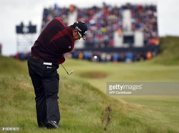 Japan's Hideki Matsuyama plays from the rough on the 6th hole during his opening round on the first day of the Open Golf Championship at Royal...