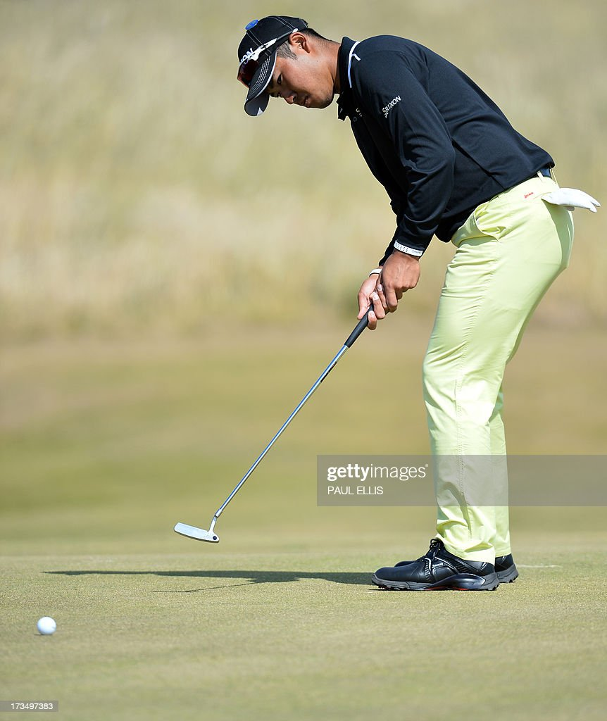 Japan's Hideki Matsuyama putts on the seventh green at Muirfield golf course at Gullane in Scotland on July 15, 2013 ahead of The 2013 Open Golf Championship. AFP PHOTO/Paul Ellis