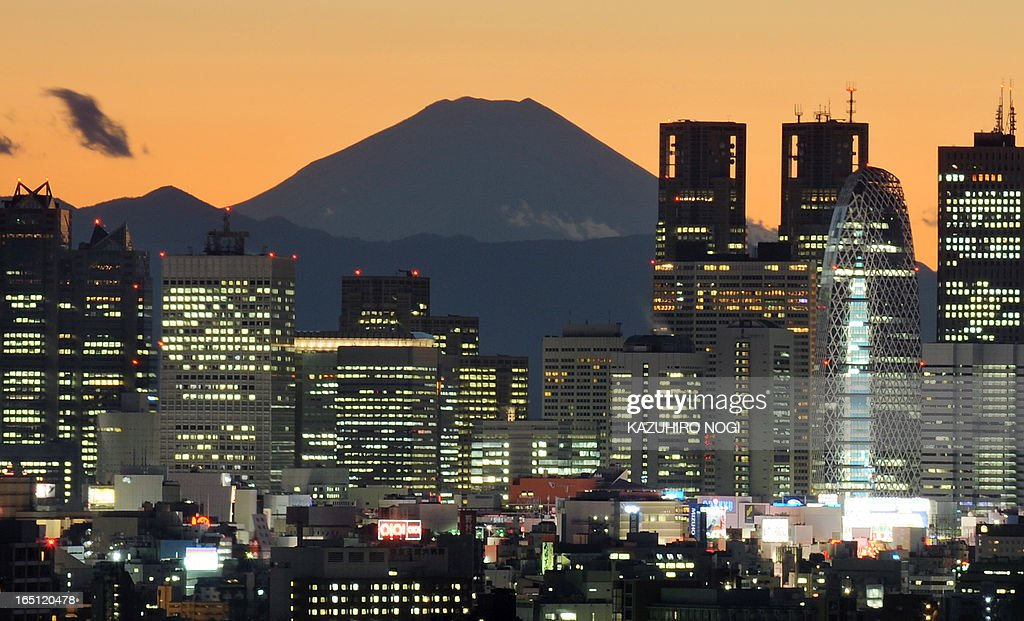 Japan's highest mountain, Mt. Fuji is seen in the background between skyscrapers in Tokyo's Shinjuku area during the sunset on January 7, 2011. Japanese shares soared during the first trading week of 2011, and investors are hungry for further gains in the weeks to come amid ballooning optimism for US economic recovery, analysts said.