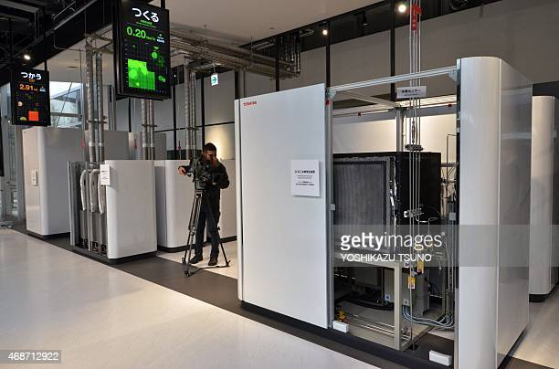 Japan's hightech giant Toshiba displays a solid oxide electrolysis cell hydrogen production unit at the company's newly built hydrogen research and...