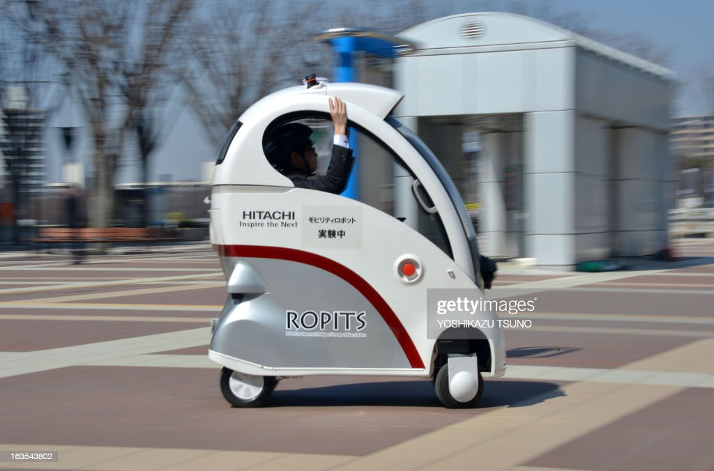 Japan's high-tech maker Hitachi unveils the new mobility robot 'Ropits' (Robot for Personal Intelligent Transport System) in Tsukuba in Ibaraki prefecture on March 12, 2013. The one man mobility robot can pick-up and drop off a passenger autonomously, while the vehicle can be controled by a joystick controler in the cockpit. AFP PHOTO / Yoshikazu TSUNO