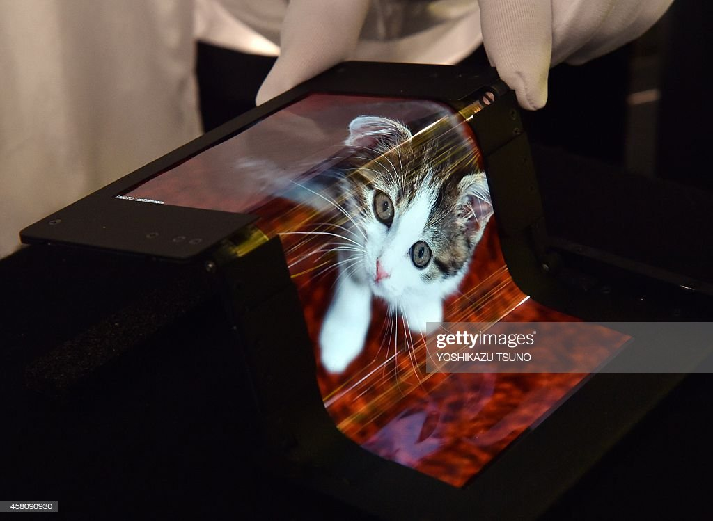Japan's hightech venture Semiconductor Energy Laboratory displays a 59inch sized foldable organic light emitting diode display at the Display...