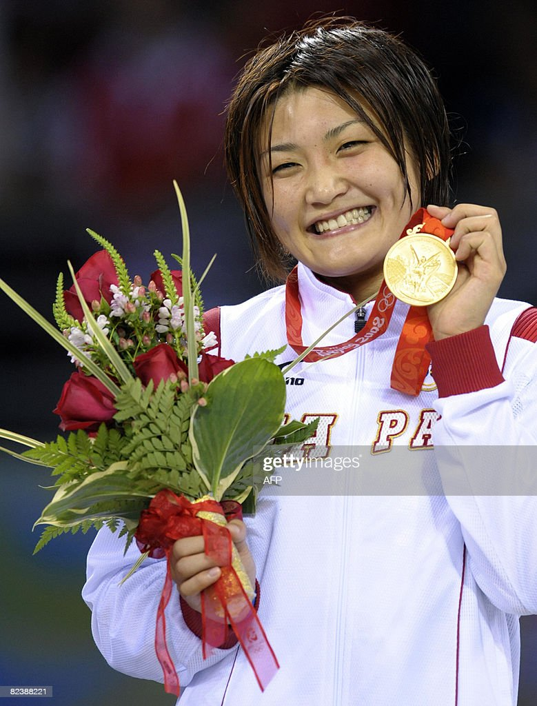 Japan's Icho Kaori poses with her gold medal on the podium of the wrestling women's 63kg freestyle at the 2008 Beijing Olympic Games on August 17, 2008 at the China Agricultural University Gymnasium in Beijing .