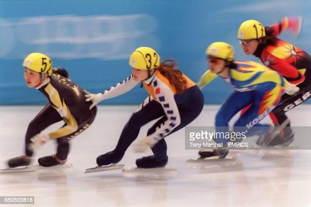 Japan's Ikue Teshigawara Netherland's Melanie De Lange Korea's YunMi Kim and Germany's Susanne Busch battle for qualification