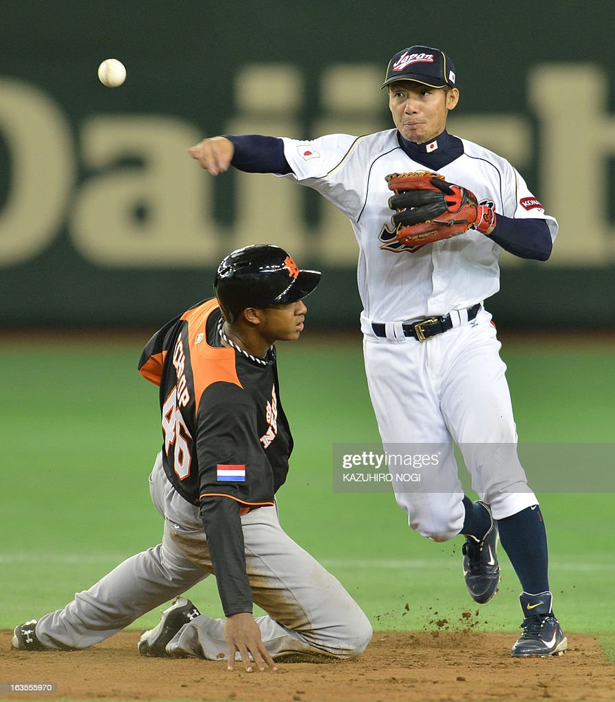 Japan's infielder Takashi Toritani tries to get a double play over Netherlands' runner Jonathan Schoop during the 9th inning of the second-round Pool 1 game in the World Baseball Classic tournament at Tokyo Dome on March 12, 2013. Japan beat the Netherlands 10-6.