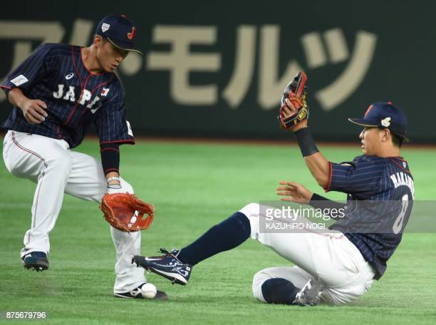 Japan's infielders Shogo Nakamura and Ryoma Nishikawa try to get a fly in the fourth inning during the Asia Professional Baseball Championships...
