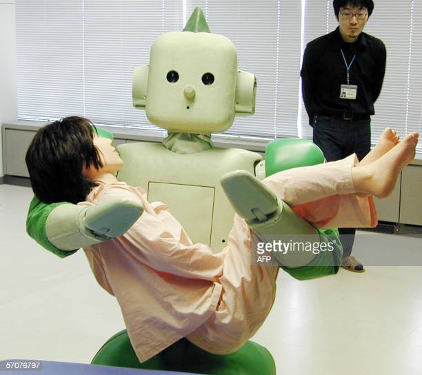 Japan's Institute of Physical and Chemical Research unveils the new nursingcare robot 'RiMan' sweeping up a lifesized doll with his sillicone made...