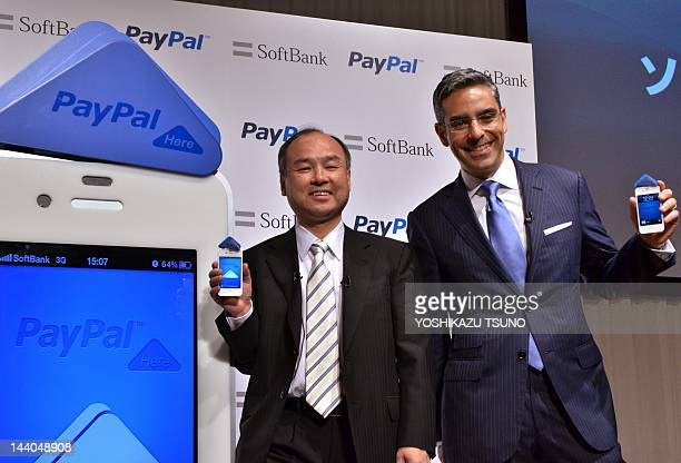 Japan's Internet giant Softbank president Masayoshi Son US online transaction giant eBay's subsidiary PayPal president David Marcus show their...