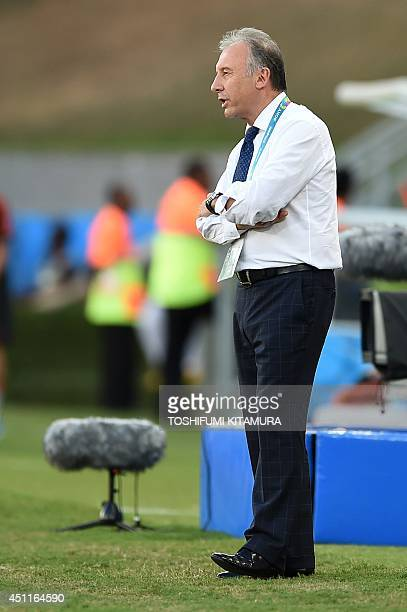 Japan's Italian coach Alberto Zaccheroni shouts at his team from the sidelines during a Group C football match between Japan and Colombia at the...