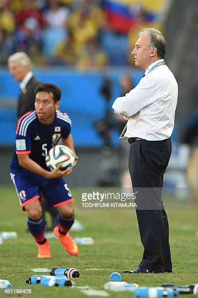Japan's Italian coach Alberto Zaccheroni watches his team from the sidelines during a Group C football match between Japan and Colombia at the...