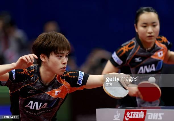 Japan's Ito Mima and Morizono Masataka play during the mixed doubles final match against China's Zhou Yu and Chen Xingtong at the Asian Table Tennis...