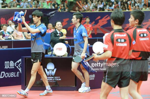 Japan's Jin Ueda and Rio Olympic team silver medalist Maharu Yoshimura react to the crowd after winning the men's doubles at the China Open in...