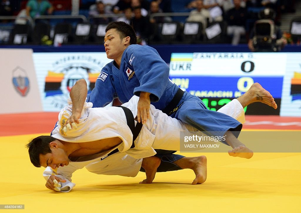Japan's judoka Kengo Takaichi (blue) competes with Ukraine's Georgii Zantaraia during the under 66 kg category competition for bronze medal at the IJF World Judo Championship in Chelyabinsk on August 26, 2014.