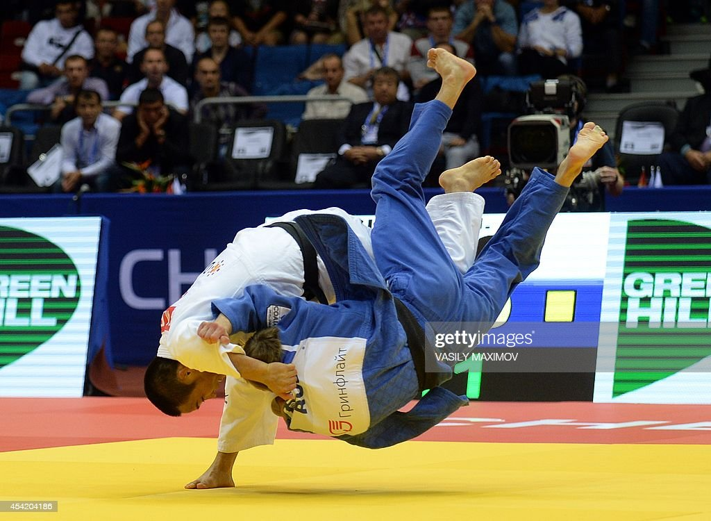 Japan's judoka Masashi Ebinuma (white) competes with Russia's Mikhail Pulyaev during the under 66 kg category final at the IJF World Judo Championship in Chelyabinsk on August 26, 2014.