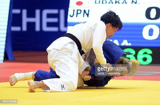 Japan's judoka Nae Udaka competes with France's Automne Pavia during the under 57 kg category semifinal at the IJF World Judo Championship in...