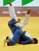 Japan's judoka Naochisa Takato competes with Kazakhstan's Aibek Imashev during the under 60 kg category competition for bronze medal at the IJF World...