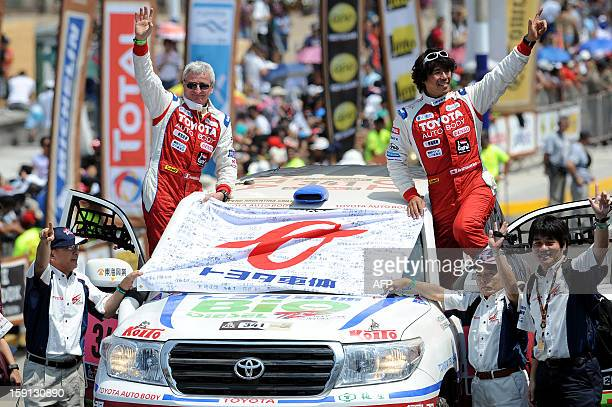 Japan´s Jun Mitsuhashi and France´s Alain Guehennec are seen in their Toyota during the 2013 Dakar Rally departure ceremony in Lima on January 5 2013