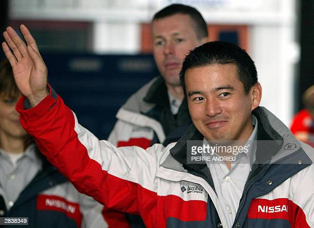 Japan's Jun Mitsuhashi waves during a press conference on the eve of the beginning of the 26th ParisDakar edition 31 December 2003 in Clermont...