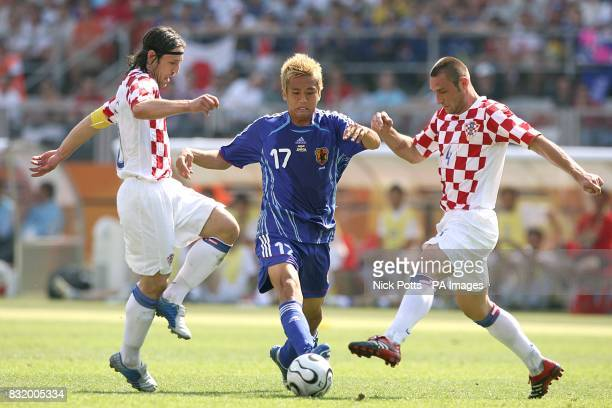 Japan's Junichi Inamoto and Croatia's Robert Kovac and Nico Kovac