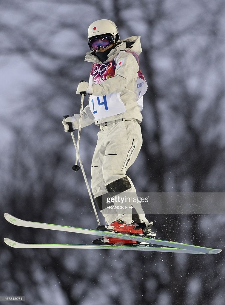Japan's Junko Hoshino competes in the Women's Freestyle Skiing Moguls qualification run at the Rosa Khutor Extreme Park during the Sochi Winter...