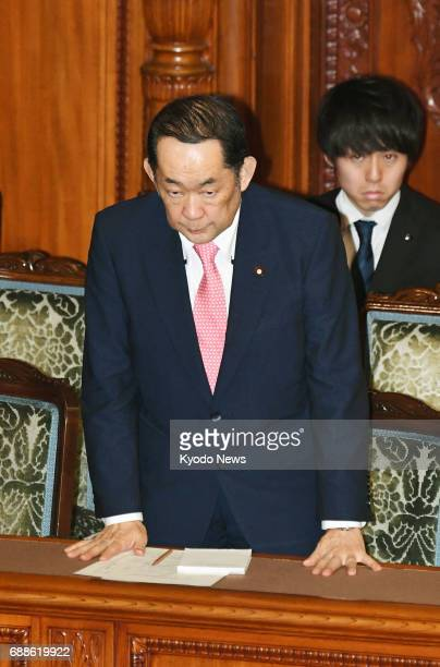 Japan's Justice Minister Katsutoshi Kaneda bows after parliament revises the Civil Code during an upper house plenary session in Tokyo on May 26 2017...